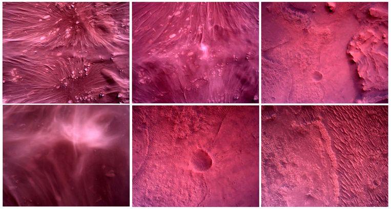 De oppervlakte van Mars. De paarse gloed ontstaat door het rode stof dat opwaait in de ijle dampkring van de planeet. Beeld NASA/JPL-Caltech/Handout via Reuters
