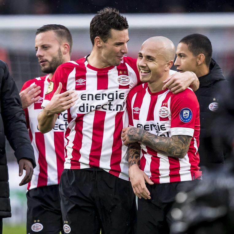 PSV'ers Nick Viergever en Jose Angelino na de 3-0 overwinning op  Ajax, 23 september 2018. Beeld ANP