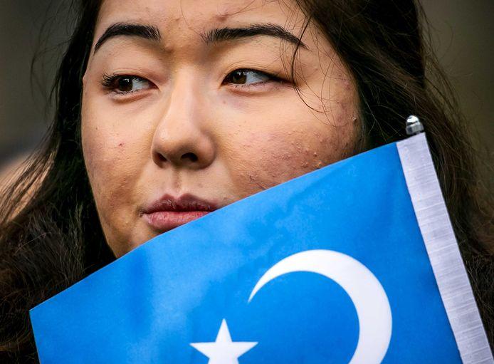 Demonstratie van Oeigoeren en sympathisanten in 2019 in Amsterdam. Ze voeren actie tegen wat zij zien als de onderdrukking van de Oeigoeren in China.