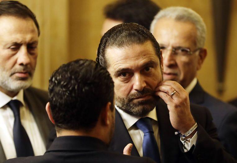 De Libanese premier Saad Hariri heeft zijn aftreden aangekondigd na massale protesten. Beeld AFP