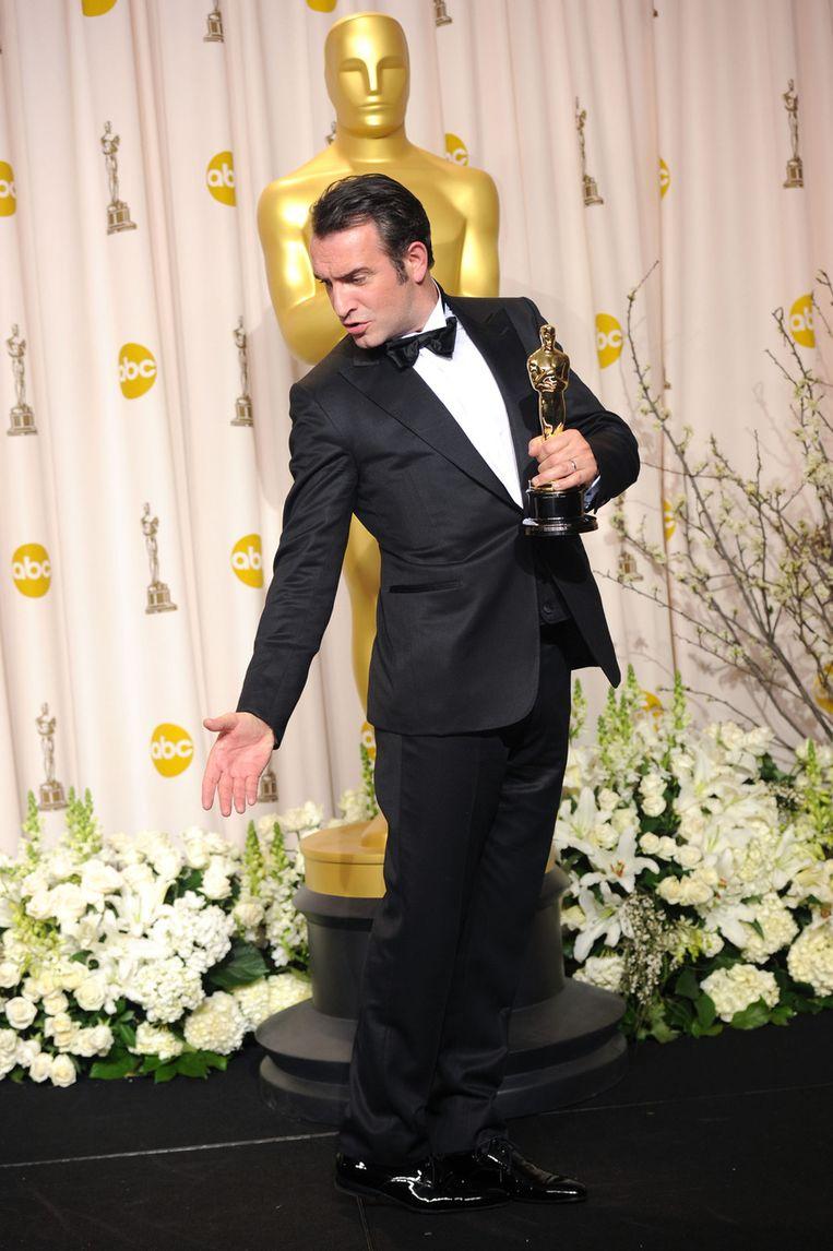 Jean Dujardin doet een vreugdedansje. Beeld GETTY