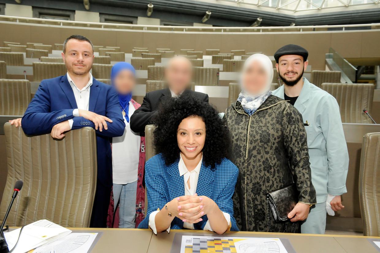 Sihame el Kaouakibi Open VLD en familie - links Nourdine - rechts Youssef. Said staat niet op de foto Beeld Photo News