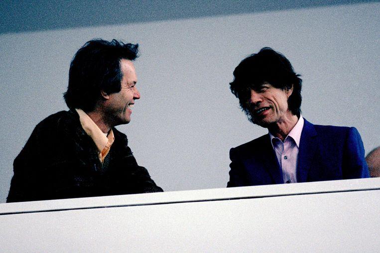 Met Mick. 'Om qualitytime met mijn broer te hebben, moet ik in competitie gaan met het merk Rolling Stones en een duizend man sterke entourage.' Beeld Redferns