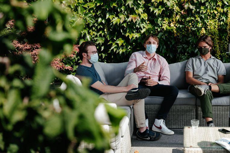 Tim, Robrecht en Lucas, drie goede vrienden van Sanda Dia. Beeld Damon De Backer