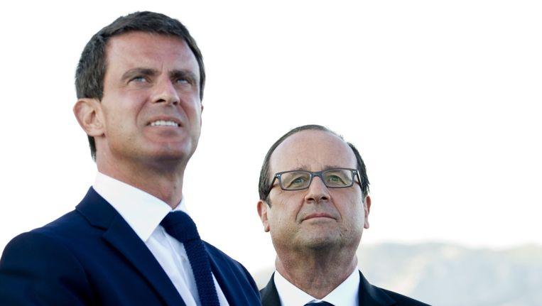 De Franse premier Valls (links) en president Hollande kijken uit naar betere populariteitscijfers. Beeld AFP