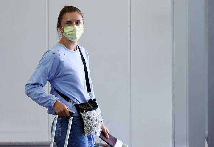 De Wit-Russische atlete Kristina Tsimanoeskaja op het Narita vliegveld nabij Tokio. (04/08/2021)