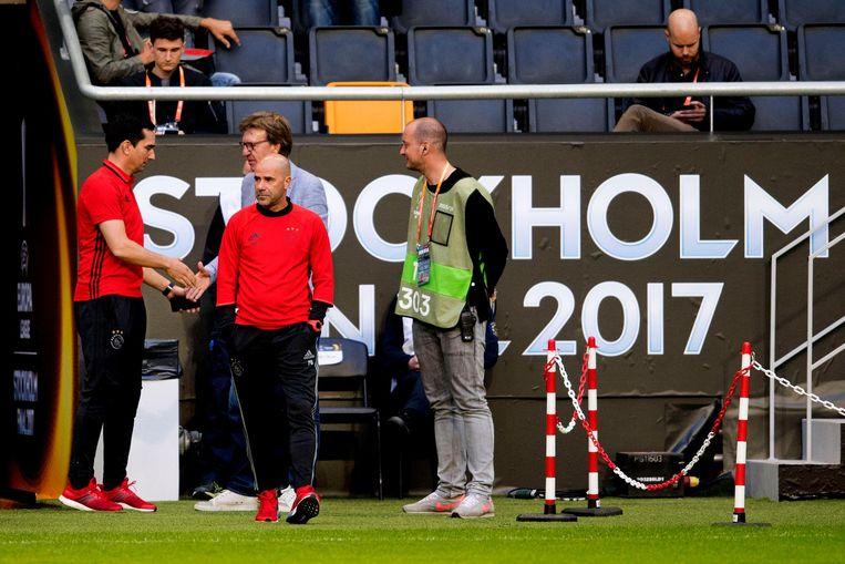 Peter Bosz neemt een kijkje in de Friends Arena voor de Europa League-finale tegen Manchester United. Beeld anp