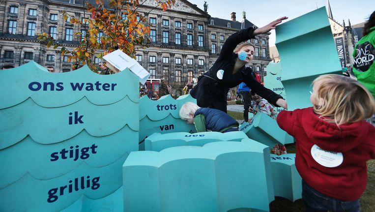 Amsterdam is deze week gastheer van de International Water Week, waarbij 25.000 politici, zakenmensen en deskundigen praten over klimaatverandering. Beeld Jean-Pierre Jans