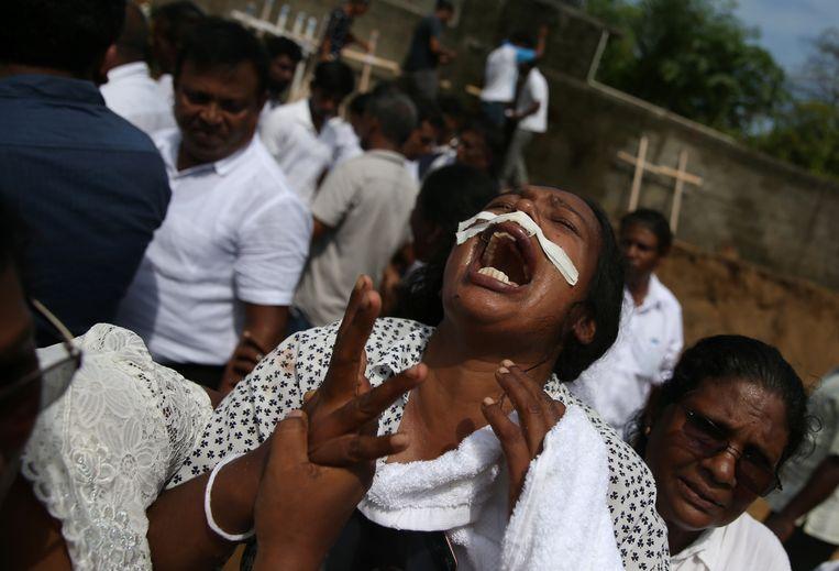 Rouwenden in Sri Lanka. Beeld REUTERS