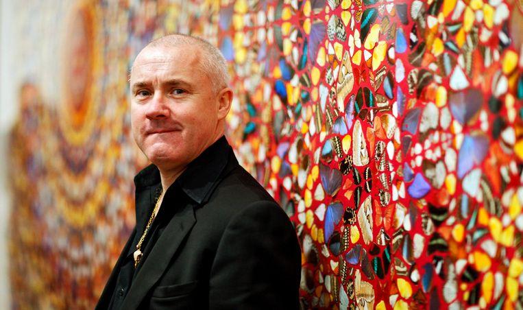Damien Hirst voor één van zijn werken Beeld EPA