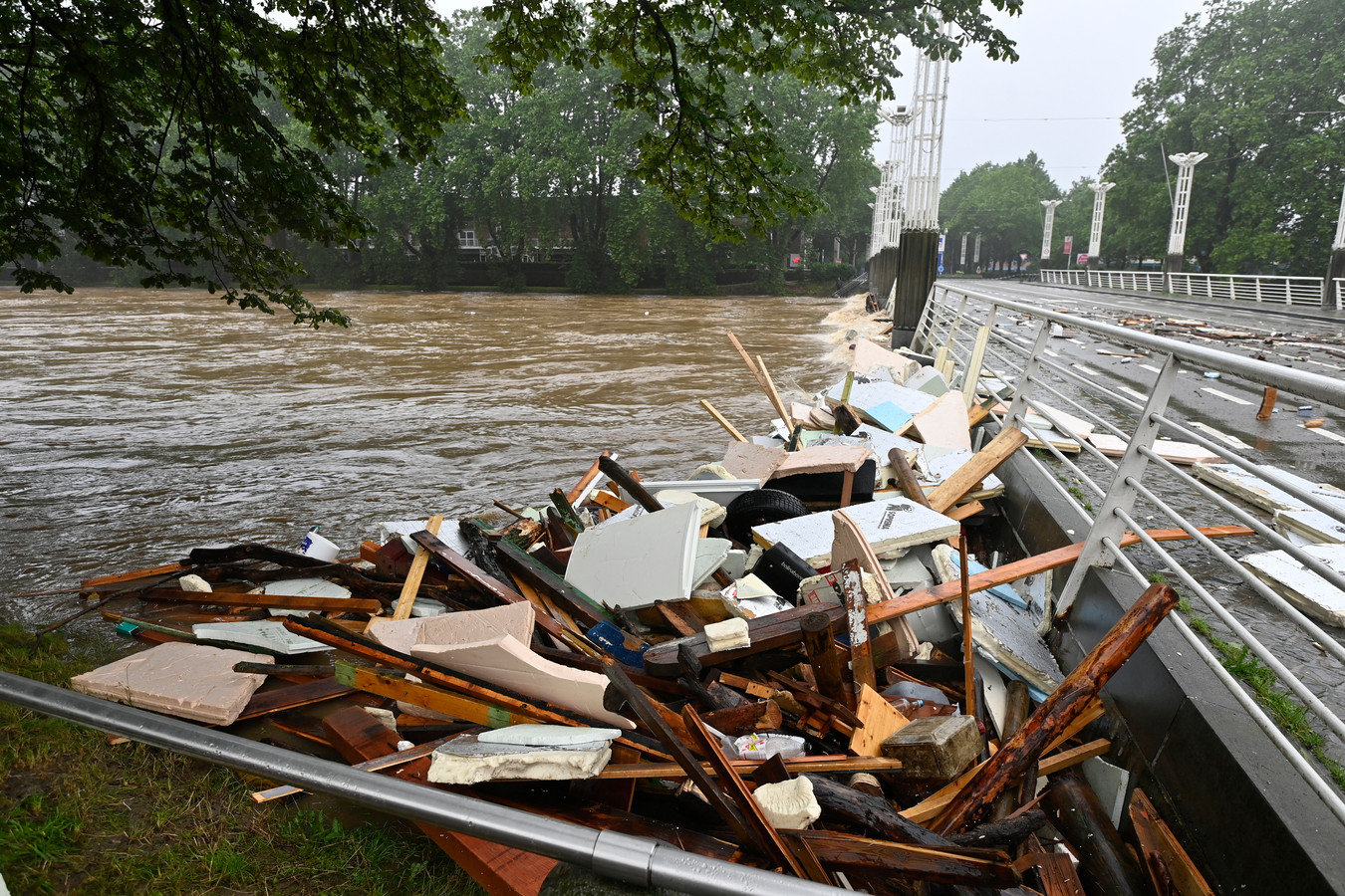 Illustration shows damage in front of the closed Belle-Ile bridge with the floods in Liege after heavy rainfall, Thursday 15 July 2021. The provincial disaster plan has been declared in Liege, Luxembourg and Namur provinces after large amounts of rainfall. Water in several rivers has reached alarming levels. BELGA PHOTO ERIC LALMAND