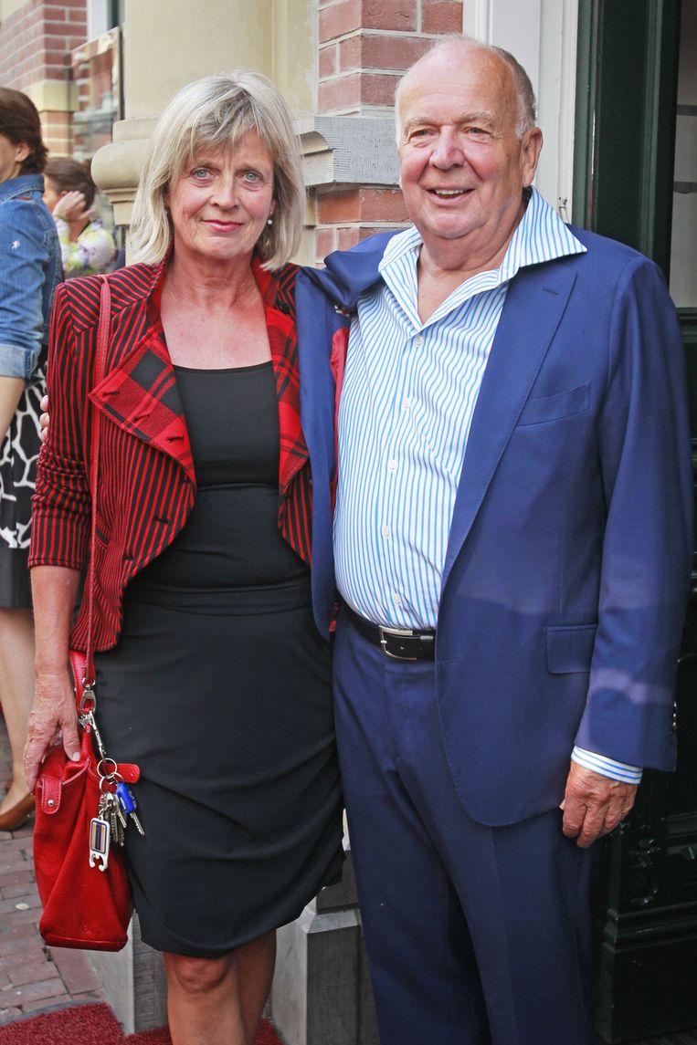 Acteur Rob van der Meeberg (R) met partner. Beeld