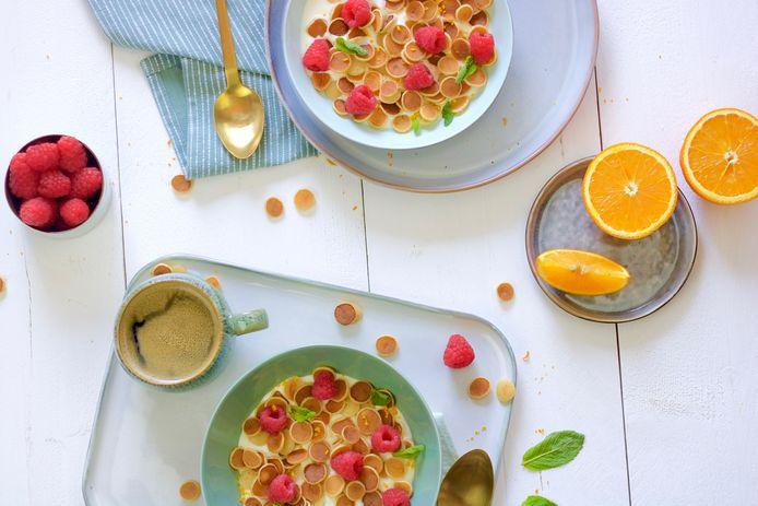 Pancake cereal met sinaasappel en frambozen