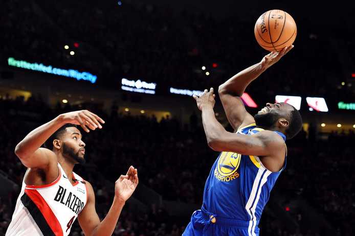 Maurice Harkles (links) en Draymond Green.
