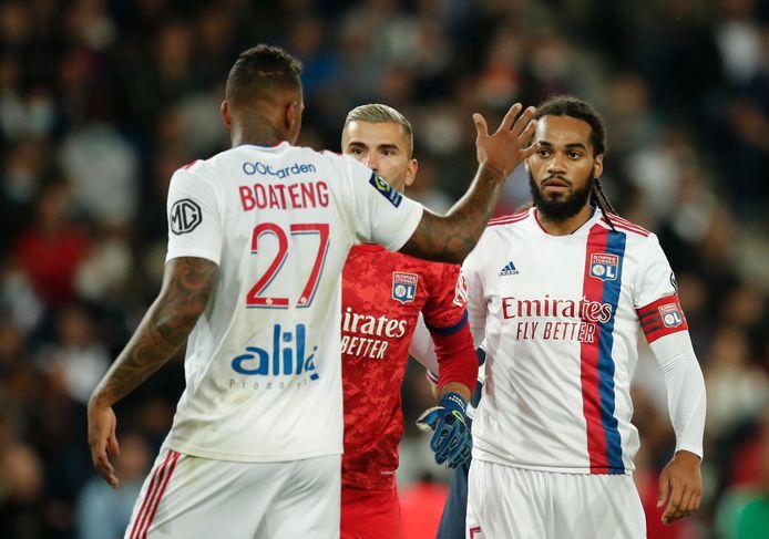 Jason Denayer, hier met Jerome Boateng, was kapitein bij Olympique Lyon.