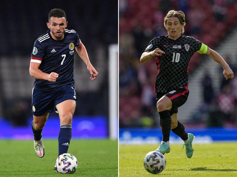 Middenvelders John McGinn (Schotland, links) en Luka Modric (Kroatië, rechts) nemen het dinsdagavond tegen elkaar op in een directe strijd om de achtste finales. Beeld AFP
