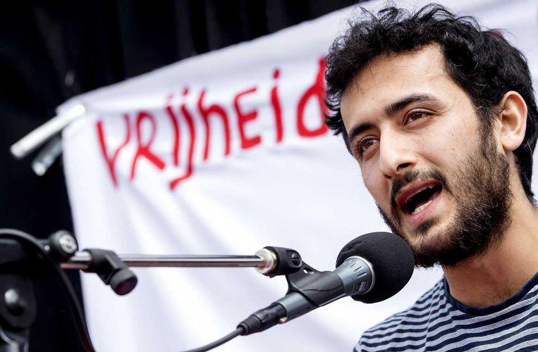 Abulkasim Al-Jaberi spreek tijdens een demonstratie op het Museumplein. Beeld anp