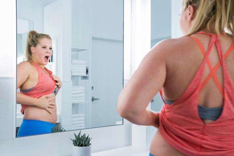 Na een val ziet Renee (gespeeld door Amy Schumer) in de spiegel de vrouw die ze altijd al heeft willen zijn: knap en zelfverzekerd.  Beeld Photo News