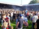 Groot feest na promotie De Graafschap: fans bestormen veld, buikschuiver in binnenstad