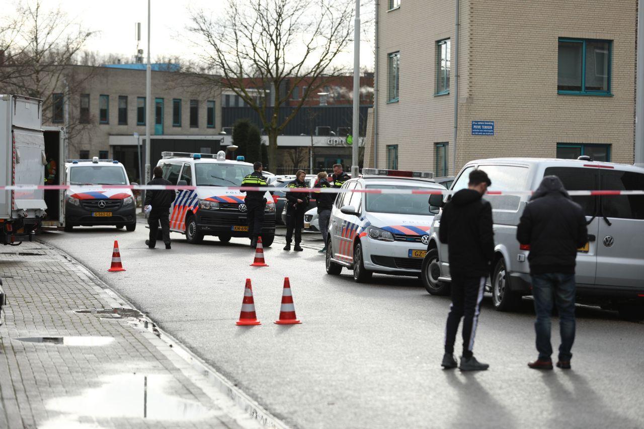 De politie verricht onderzoek naar de brandstichting in het pand op Kerkenbos in Nijmegen.