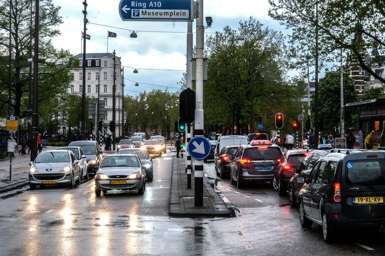 Door het weinige verkeer van afgelopen jaar voldeden voor het eerst alle meetpunten in Amsterdam aan de norm die door de WHO wordt gesteld. Beeld Hollandse Hoogte / Joris van Gennip