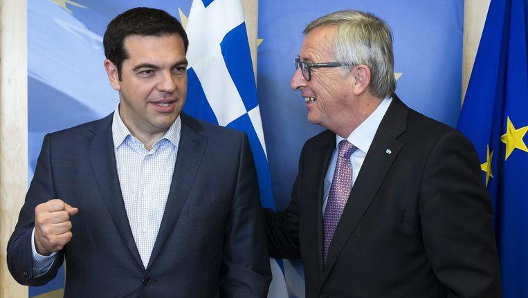 De Griekse premier Alexis Tsipras en Commissievoorzitter Juncker vanmiddag in Brussel. Beeld EPA