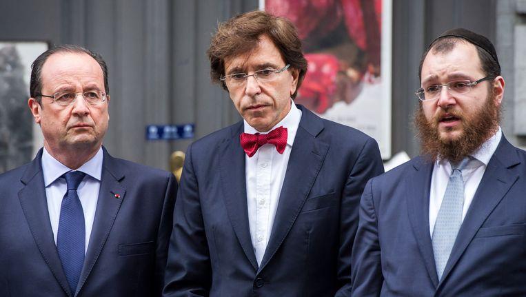President Francois Hollande van Frankrijk en de Belgische premier Elio Di Rupo herdenken de aanslag. Beeld ap