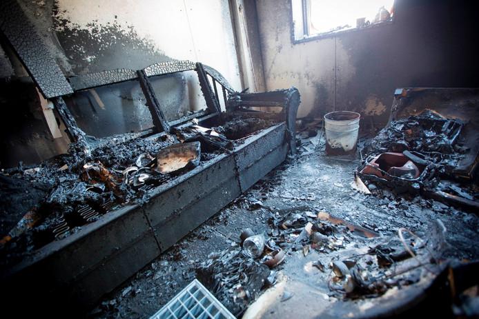 Een zwartgeblakerde kamer in het brandonderzoeksgebouw na een nagebootste brand. Foto: Robin Hilberink