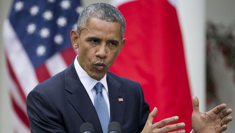 Obama tijdens de persconferentie in de Rose Garden. Beeld ap