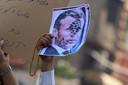Portrait d'Emmanuel Macron brandi lors d'une manifestation au Pakistan
