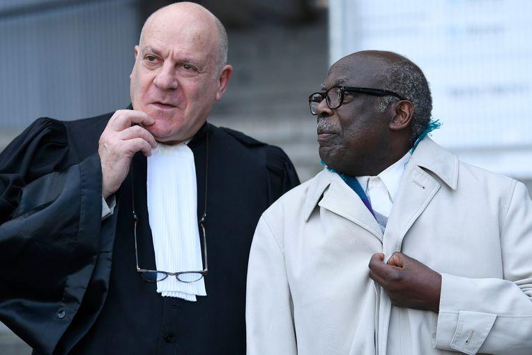 Advocaat Jean Flamme (l) en de veroordeelde Fabien Neretse (r). Beeld Photo News