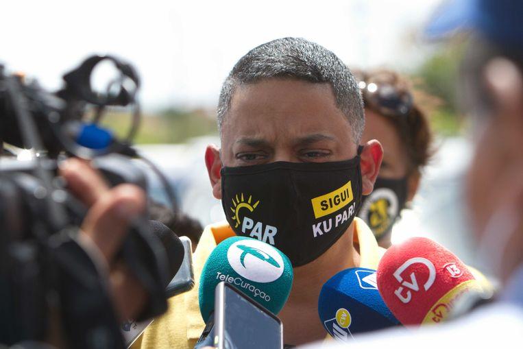'We moeten er alles aan doen om verspreiding van corona te voorkomen,' stelde minister-president Eugene Rhuggenaath.  Beeld ANP