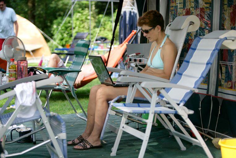 Campingleven met laptop. Beeld ANP