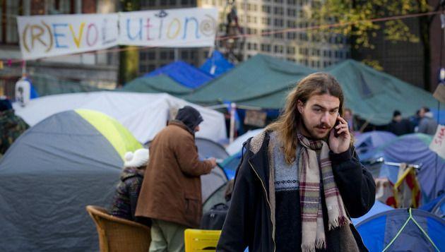 Actievoerders op het Beursplein in Amsterdam. © ANP