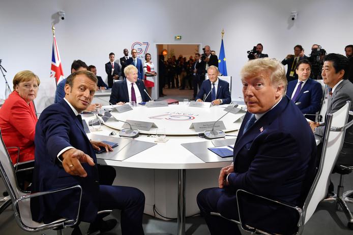 Wereldleiders op de laatste G7 met Angela Merkel (Duitsland) en Emmanuel Macron (Frankrijk) aan de linkerkant en Donald Trump (VS) en Shinzo Abe (Japan) ter rechterzijde.