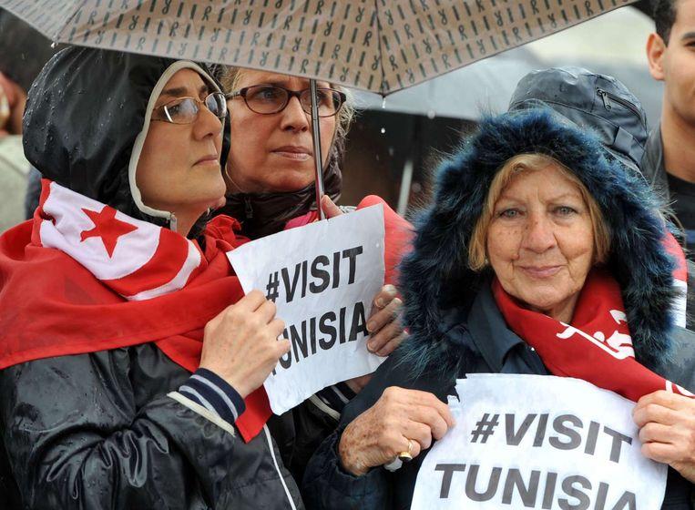 Een demonstratie gisteren in Tunis. Beeld afp
