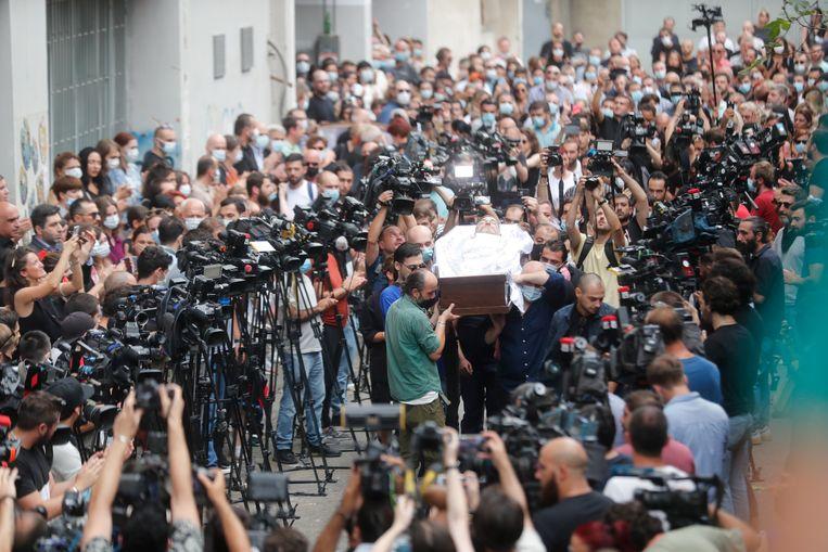De begrafenis van cameraman Lekso Lashkarava  in Tbilisi, Georgië, op 13 juli.  Beeld EPA