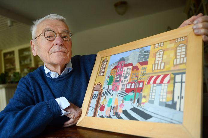 Bart van Winsen met het schilderij dat hij van een 12-jarig meisje in Belgrado kreeg.