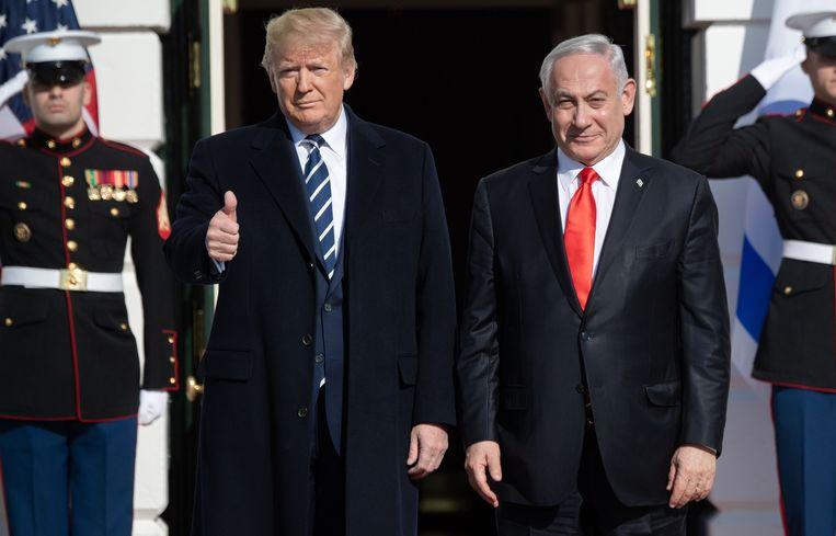De Amerikaanse president Donald Trump en de premier van Israël Benjamin Netanyahu gisteren bij aankomst aan het Witte Huis.