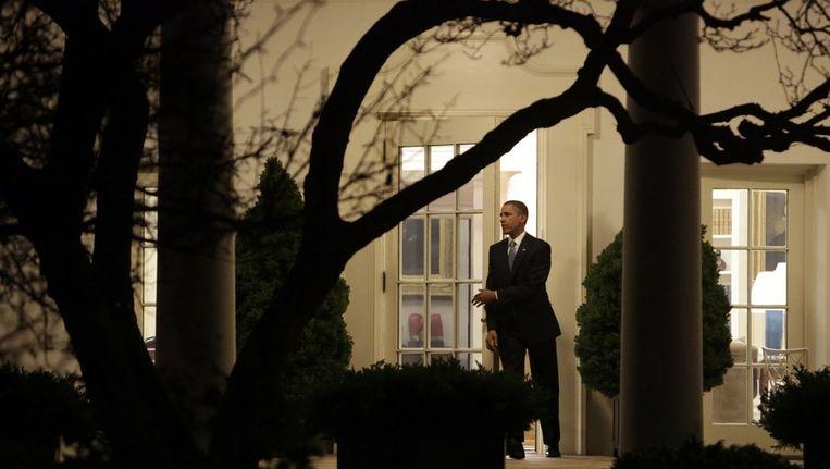 De Amerikaanse president Barack Obama verlaat het Witte Huis. Beeld afp