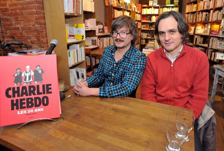 Riss (r.) aan de zijde van Luz (l.), die de cover van het laatste wapenfeit van Charlie Hebdo voor zijn rekening nam. Beeld EPA