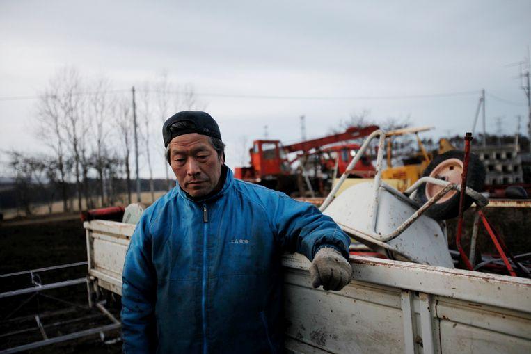 Masami Yoshizawa is een van de weinige boeren die nog vee houdt inNamie. Beeld Hollandse Hoogte / Laif