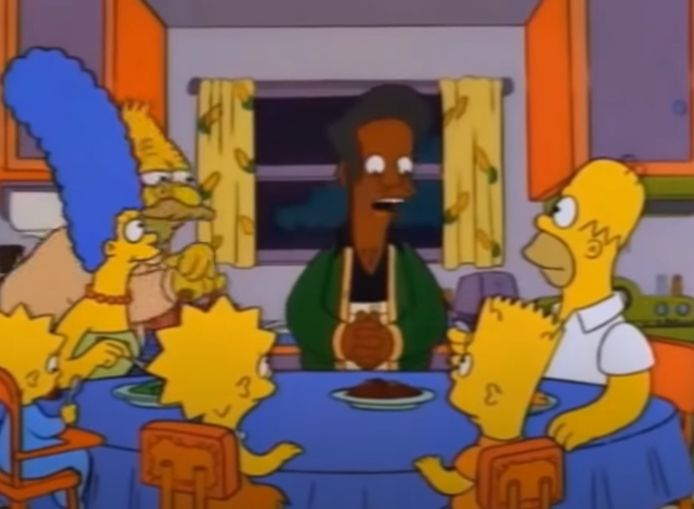 Apu entouré par la famille Simpsons