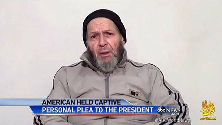 De gijzelaar Warren Weinstein in een video waarin hij president Obama smeekt om hem te helpen. Beeld screenshot