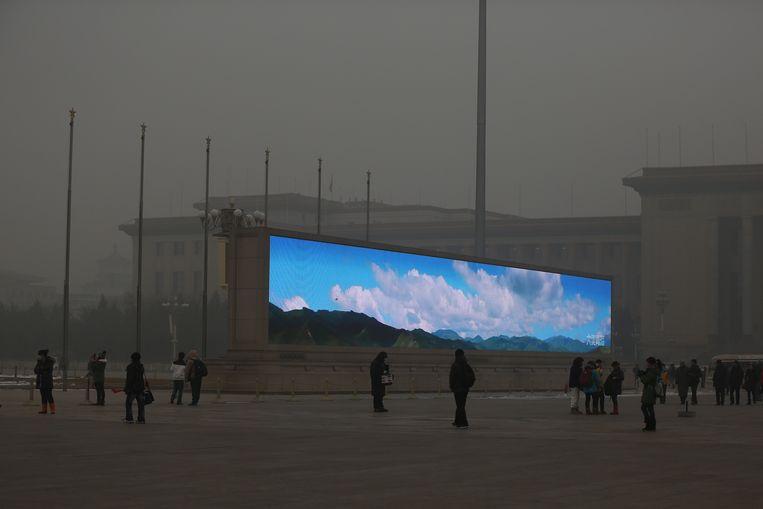 Het gigantische televisiescherm op het plein, deze keer met een andere afbeelding. Beeld Getty Images