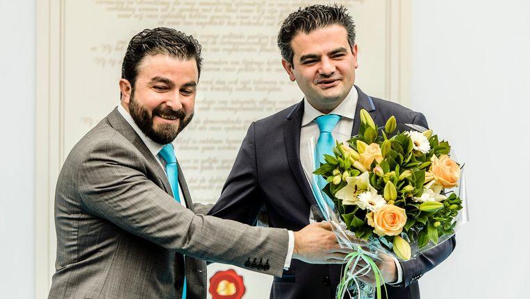 Partijvoorzitter Selcuk Ozturk (L) en lijsttrekker Tunahan Kuzu tijdens de opening van het partijbureau van de politieke beweging Denk. Beeld anp