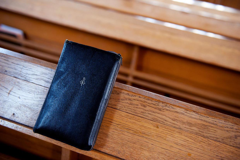 Een psalmboek in een kerkbank. Bij de psalmen staat psalm 68 het hoogst genoteerd in de klassiekerlijst van De Muzikale Fruitmand.  Beeld ANP