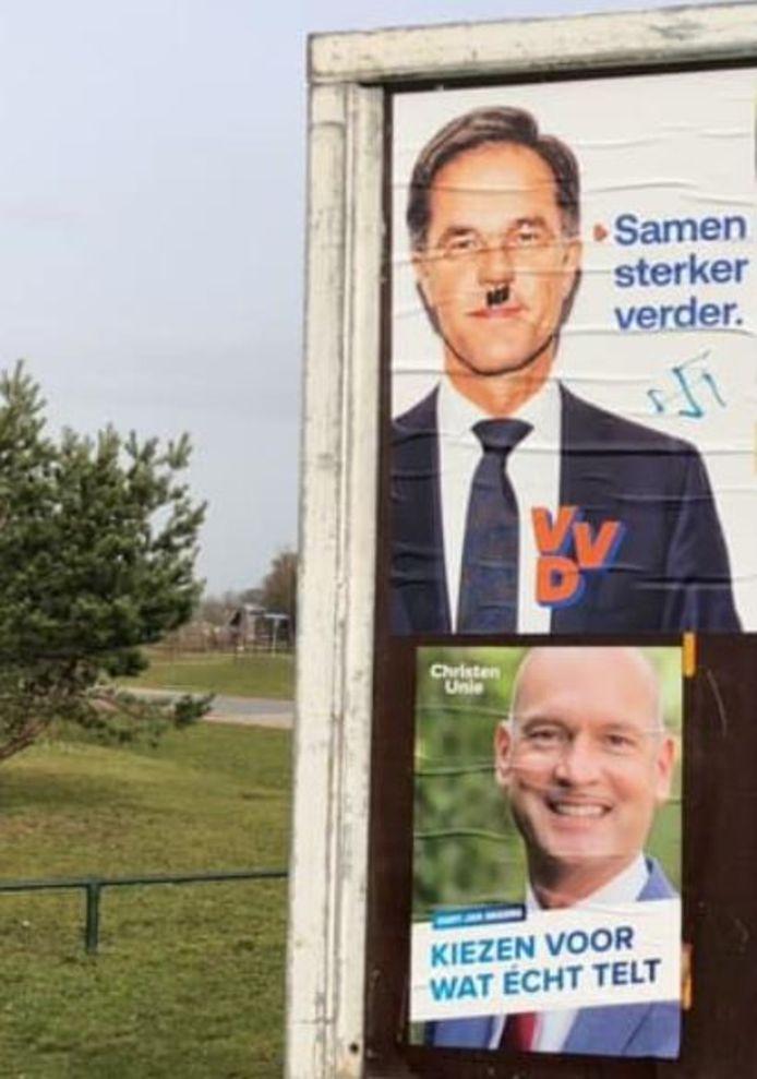 Posters van de VVD werden in Putten beklad met nazi-tekens.