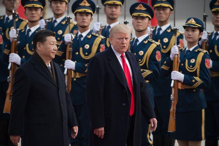 Archieffoto: Chinese president Xi Jinping (links) en Amerikaans president Donald Trump (rechts).