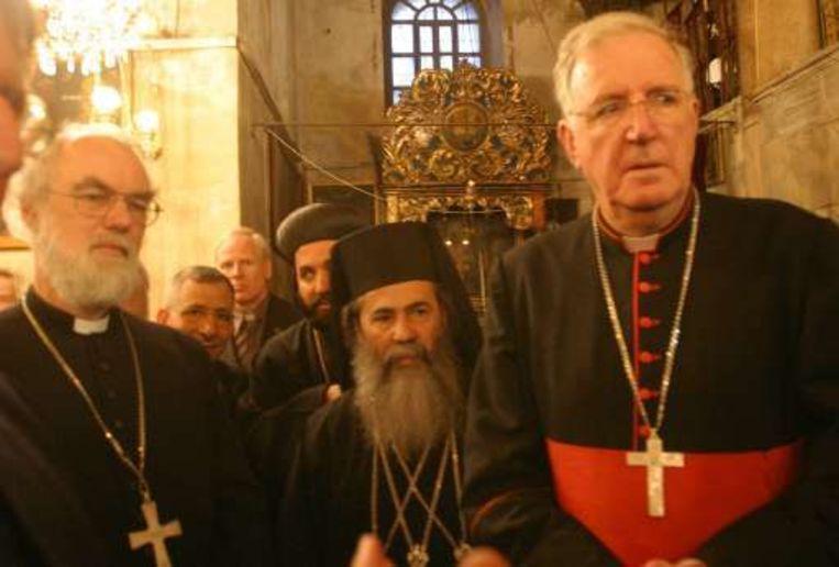 Links Rowan Williams, aartsbisschop van Canterbury. Beeld UNKNOWN